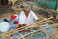 Phuket, Thailand: Fisherman Sewing Trap Netting Stock Image
