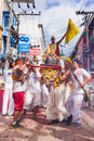 Phuket vegetarian festival oct devotees of a chinese taoist shrine carry a palanquin housing a chinese god idol in a street Stock Photography