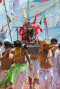 Phuket vegetarian festival oct devotees of a chinese taoist shrine carry a palanquin housing a chinese god idol in a street Stock Images