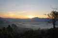 Phulangga sunrise with mist and mountauin view at phrayoa Stock Photos