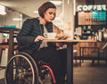 Physically challenged women in a cafe Royalty Free Stock Photo