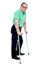 Physically disabled old man with crutches Royalty Free Stock Photos