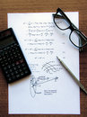 Physics exercises written on a white paper Royalty Free Stock Photo