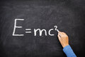 Physics science formula equation blackboard e mc emc written on chalkboard by teacher or student in class Stock Images