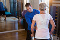 Physiotherapist assisting patient to walk with walking frame Royalty Free Stock Photo