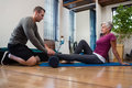 Physiotherapist giving physical therapy of leg to senior patient Royalty Free Stock Photo