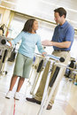 Physiotherapist With Patient In Rehabilitation Stock Images