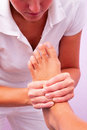 Physiotherapy foot reflexology in studio Stock Photos