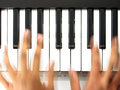Pianist in action, playing a piano Royalty Free Stock Photo