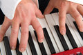 Pianist hands of on keyboard Stock Photo
