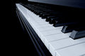 Piano d render of side view with keys lost in the dark Royalty Free Stock Photos