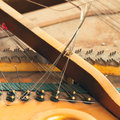 Piano disassemble old inside wire Stock Photography