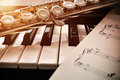 Piano and flute with golden shine and sheet music front Royalty Free Stock Photo