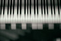 Piano keyboard background with selective focus. Blur keyboard and musical notes Royalty Free Stock Photo
