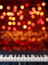 Piano keyboard front view on lights bokeh background Royalty Free Stock Photo