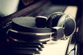 Piano keyboard and headphones with for music Stock Images