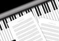 Piano keyboard with staff papers