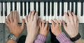 Piano Keyboard top View and Hands of Child Mother and Father Royalty Free Stock Photo