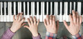Piano Keyboard top View and Hands of Child and Mother Royalty Free Stock Photo