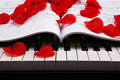 Piano keys and musical book black white of the closeup with rose petals Stock Photography