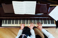 Piano lessons at a music school, teacher and student Royalty Free Stock Photo