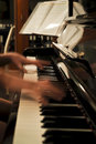 Piano practice blurred hands at the keyboard evening scene of Royalty Free Stock Images