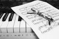 Piano sheet music and glasses a pair of kept on a bunch of script or notation they are kept on an electronic keyboard Royalty Free Stock Photo