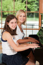 Piano Student and Teacher Stock Photo