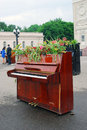 Pianos decorated by flowers the entrance to the gorky park it s decoration on the occasion of international chereshnevy les Stock Photo