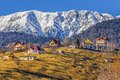 Piatra craiului mountains romania snowy mountain ridge and scattered houses uphill in pestera village brasov county travel Stock Image