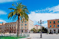Piazza d italia and palm in sassari on a cloudy day Royalty Free Stock Photos