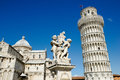Piazza dei miracoli the pisa cathedral the fountain with angels and the leaning tower of pisa in in pisa italy Royalty Free Stock Photography
