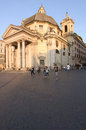 Piazza del popolo summer evening on the in rome italy in the background view on the church santa maria in montesanto Royalty Free Stock Image