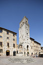 Piazza della cisterna in san gimignano tuscany italy august tourists town square of on augustl is a small walled medieval hill Royalty Free Stock Images