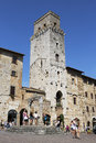 Piazza della cisterna in san gimignano tuscany italy august tourists town square of on augustl is a small walled medieval hill Royalty Free Stock Image