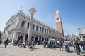 Piazza san marco with campanile in venice italy april the crowd of people basilika and doge palace Royalty Free Stock Image