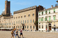 Piazza sordello in mantua italy june some people around the background torre della gabbia cage tower and palazzo Royalty Free Stock Image