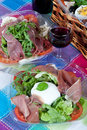 Pic-nic basket and salads Stock Images