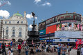 Piccadilly circus london england the fountain the tourists and the billboards at downtown Stock Photo