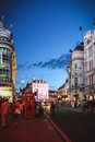Piccadilly circus at night london united kingdom july view on from the leicester square the place is crowded with people tourists Royalty Free Stock Photo