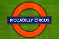 Piccadilly circus subway sign or underground on green tiled background london england Stock Photo