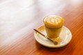 Piccolo latte art in small glass on wooden background Royalty Free Stock Photo