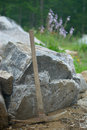 Pick Axe in Landscaped Rock Garden Royalty Free Stock Images