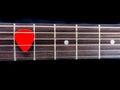 Pick guitar on finger board background black Stock Photography