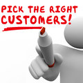 Pick the right customers target market best potential audience man writing words targeting prospects or to sell products and Stock Photography
