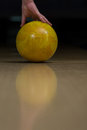 Pick up the bowling ball close of a foot next to a on a lane Stock Image
