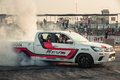 Pick-up car perform burnout tire on the track Royalty Free Stock Photo