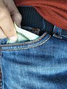 Pick up or put money in pants pocket Royalty Free Stock Photo