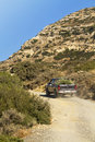 Pick up truck in the dry hills of crete Royalty Free Stock Images