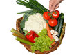 Pick vegetables from a basket Royalty Free Stock Photo